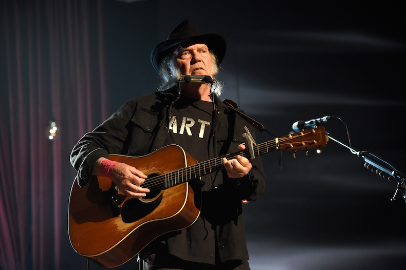 LOS ANGELES, CA - FEBRUARY 06: Neil Young performs onstage at the 25th anniversary MusiCares 2015 Person Of The Year Gala honoring Bob Dylan at the Los Angeles Convention Center on February 6, 2015 in Los Angeles, California. The annual benefit raises critical funds for MusiCares' Emergency Financial Assistance and Addiction Recovery programs. For more information visit musicares.org. (Photo by Kevin Mazur/WireImage)